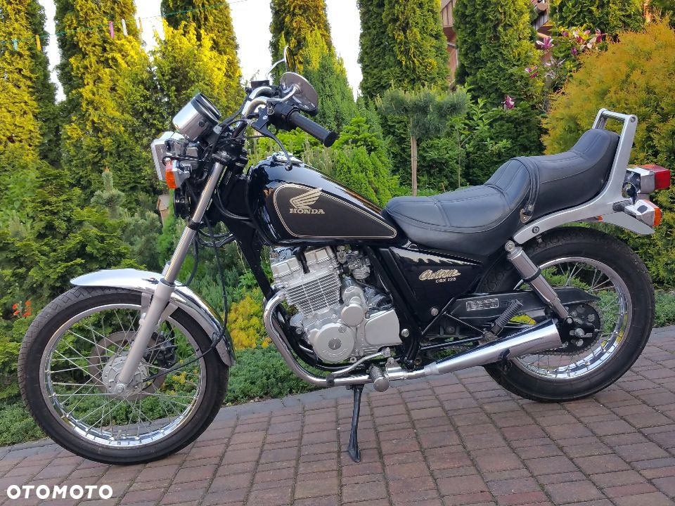 the honda 125 at the motorcycle. Black Bedroom Furniture Sets. Home Design Ideas